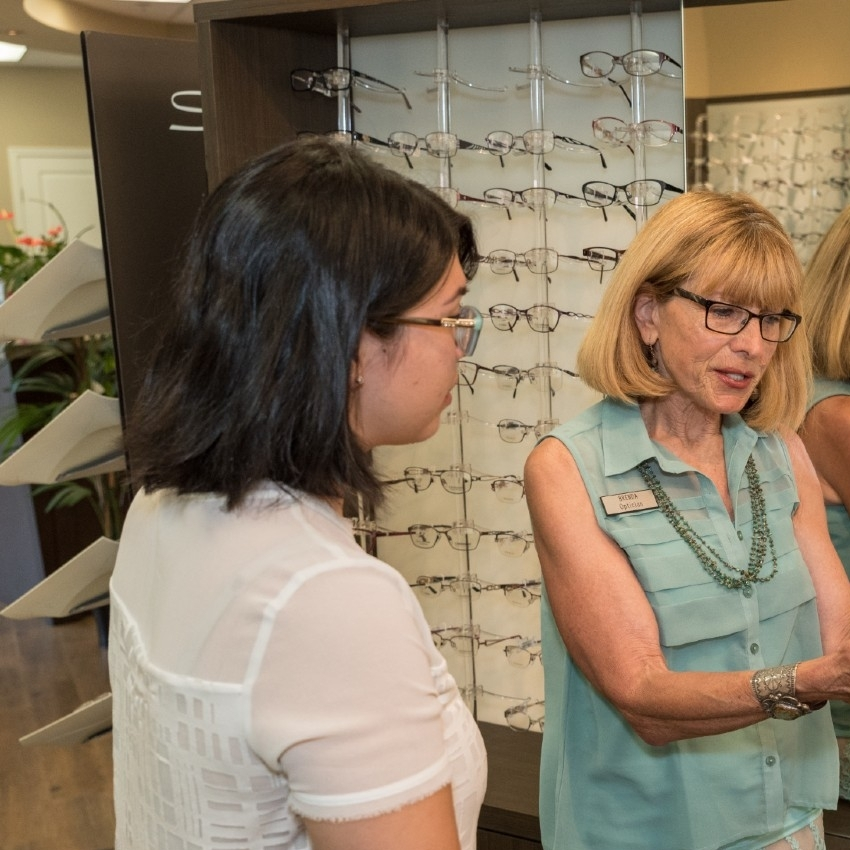 Our optician helping with selecting a frame