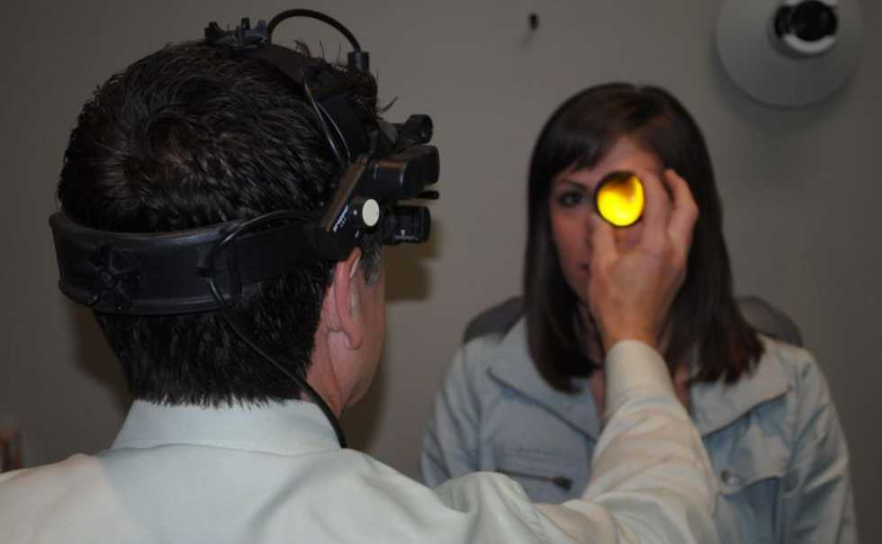 Ophthalmoscopy to determine ocular health.