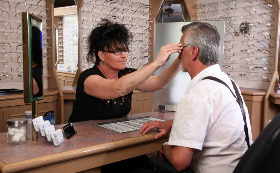 One of our CCOA trained technicians fitting glasses