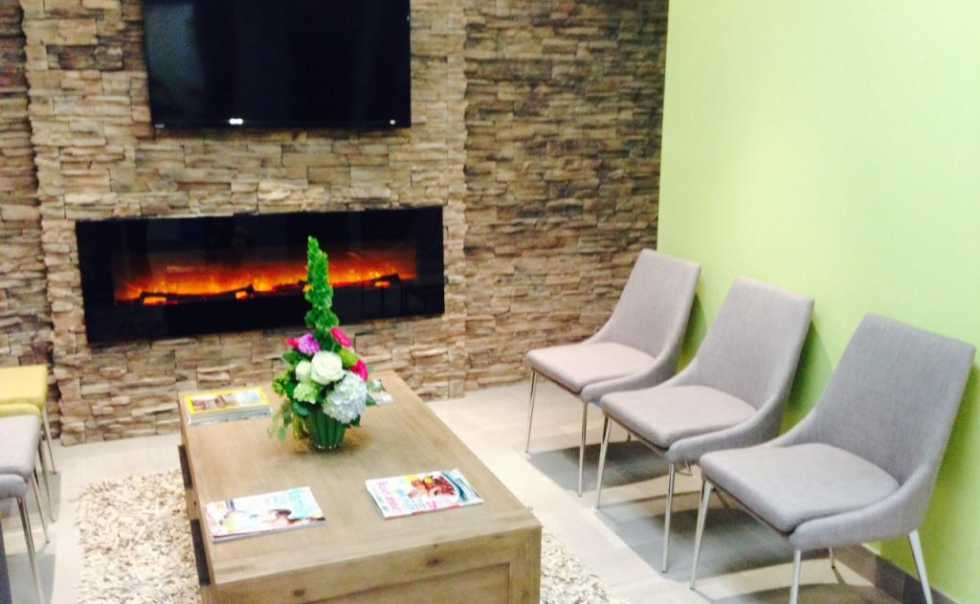 Relax by the fireplace in our lounge
